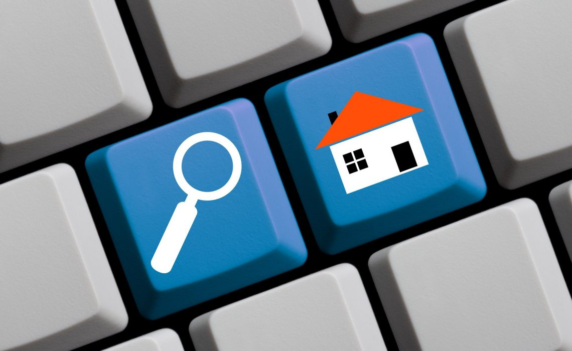 Search for real estate online - symbols on computer keyboard